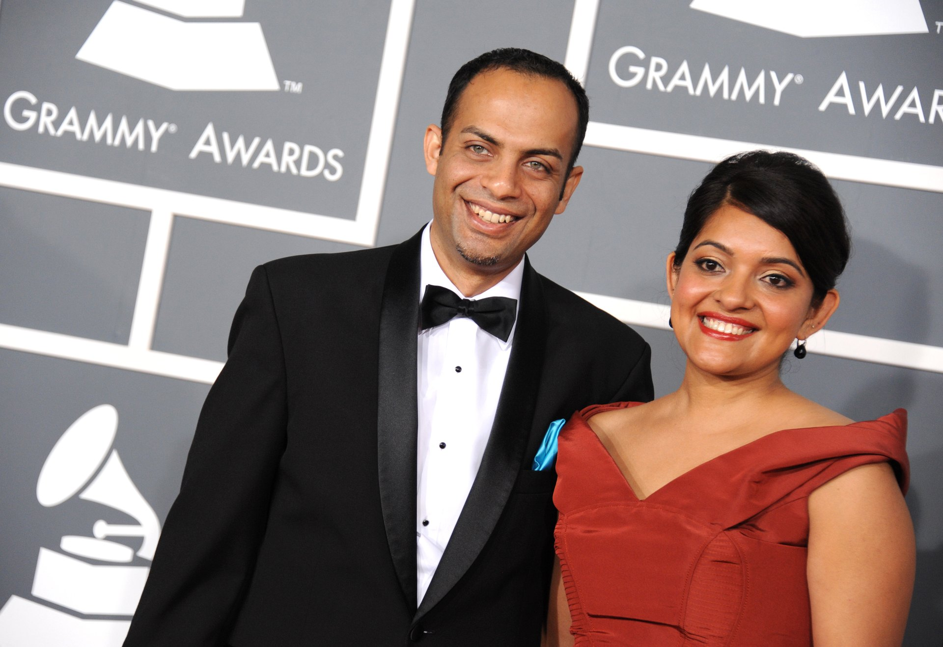 Arun Shenoy, left, and Roshni Mohapatra arrive at the 55th annual Grammy Awards on Sunday, Feb. 10, 2013, in Los Angeles. (Photo by Jordan Strauss/Invision/AP)