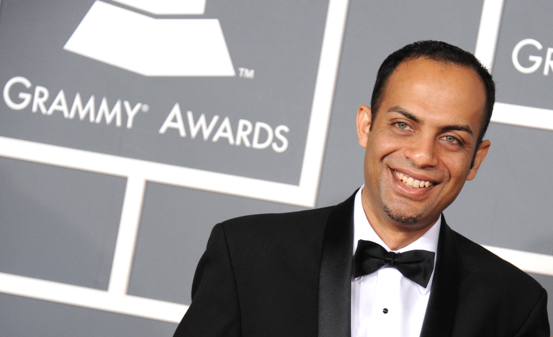 Arun Shenoy arrives at the 55th annual Grammy Awards on Sunday, Feb. 10, 2013, in Los Angeles. (Photo by Jordan Strauss/Invision/AP)